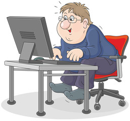 man sitting at his desk in front of a computer monitor and typing on a keyboard