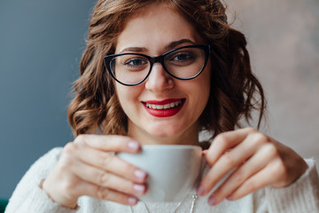 Woman enjoying in taste of coffee