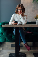 Woman using free internet in a cafe