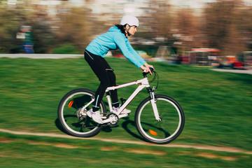 Female riding bike outdoors