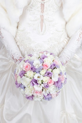 Lilac, pink and white wedding bouquet of roses, freesias and lisanthus flowers