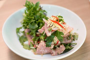 Thai sour sausage salad