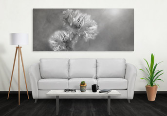 Flower on wide wall art canvas. Sofa, lamp, plant and table in room interior.