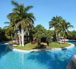 Pool amenities and landscape at a luxury tropical resort in Riviera Maya, Mexico