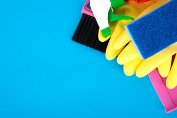cleaning tools, rubber gloves, spray, sponge on a blue background