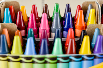 Crayons stacked on art material