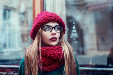 Street portrait of beautiful young  fashionable woman with glasses looking aside.  Lady wearing stylish winter clothes. Model looking aside. Female fashion. Close up