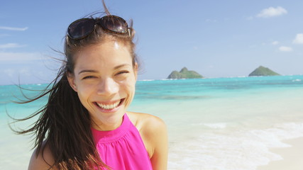 Wall Mural - Woman portrait on beach. Multiracial model on Hawaii Lanikai beach. Young mixed race Asian Chinese / Caucasian female by ocean wearing pink sundress smiling looking at camera on summer travel holidays
