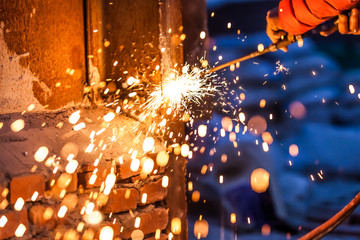 worker cutting steel board using metal torch