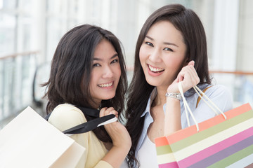 Two asian women enjoy shopping