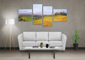 Art canvas in four parts. Landscape theme. Sofa, lamp, plant and table in room interior.