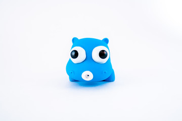 Blue isolated squeeze bath toy, hippo on white background.