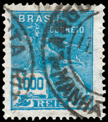Stamp printed in the Brazil shows Mercury and Globe