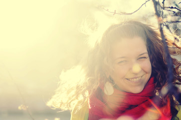 Laughing girl in sunlight with place for text