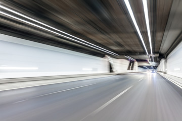 Abstract speed motion in highway road tunnel, blurred motion tow