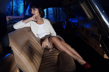 beautiful woman in the richness car