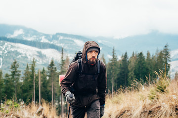 caucasian male hiking in mountains