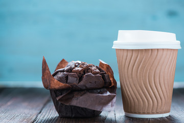 Take away coffe and chocolate muffin