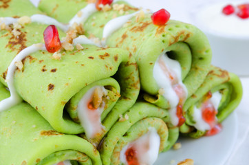 Green Russian pancakes with jam