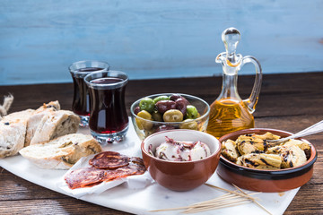 Traditional tapas served on marble board