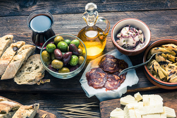 Tapas served in restaurant or bar on wooden table
