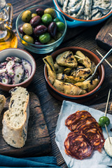 Sharing authentic spanish tapas with friends in bar