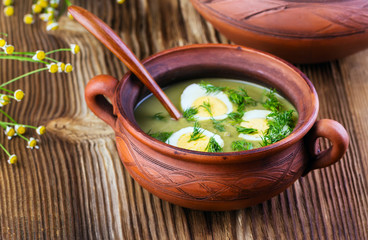 green soup-cream with egg