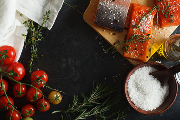 Salmon filets served on wooden kitchen board