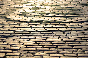 Cobblestones shining in yellow during sunset