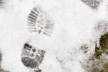 Boot print in the snow. Footprint of a shoe, winter landscape.