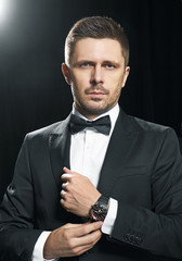 Man in black suite whit watch