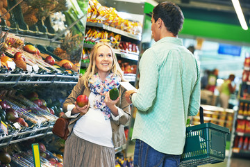 young family man and woman shopping in store