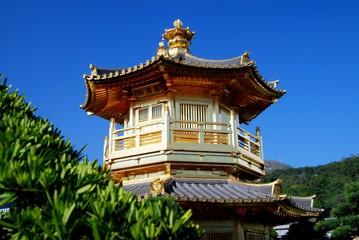 Hong Kong, China - January 2, 2008:  Hexagonal Golden Pagoda with balcony and tiled roofs in the Nan Lian Garden