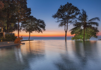 Thailand. Ko Chang.  Hotel Chang Buri Resort pool at sunset.