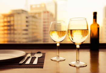 Wine glasses in a restaurant setting,