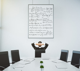 Businessman looks at the poster with equations in modern confere