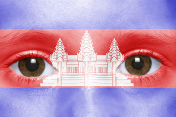 human's face with  cambodian flag
