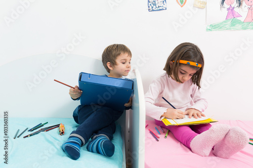 Cute Little Girl And Boy Drawing And Coloring Together In Their Room