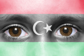 human's face with libyan flag
