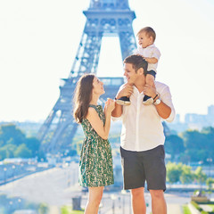 Happy family of three in Paris, France