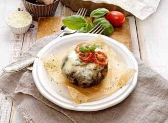 Baked portobello mushroom stuffed with cheese and vegetables. Delicious and nutritious vegetarian dish