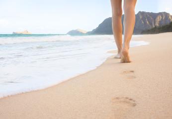 Woman walking on the beach in beautiful Hawaii.