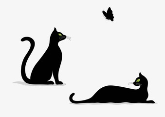 Stylized silhouette of black cats and butterfly