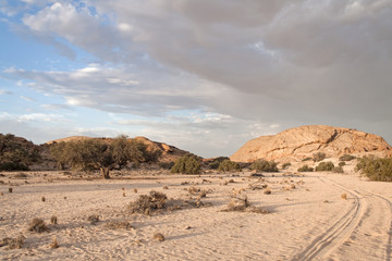 sunset with rain clouds at the edge of the Namib desert