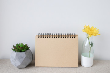 Notepad and plants pots, room interior mockup, copy space background