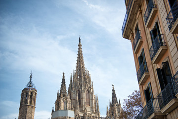 Spires of Barcelona Cathedral Against Blue Sky