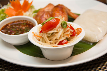 Green papaya salad, grilled chicken and sticky rice