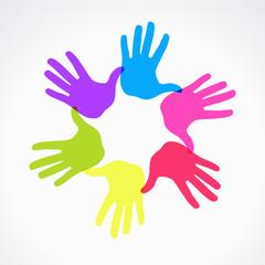 Conceptual circle of colorful hand prints