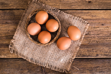chicken eggs on wooden background