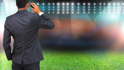 Football manager with soccer field and bright spotlights.